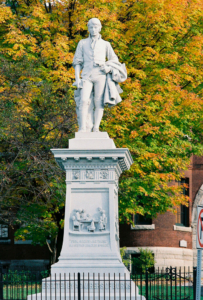 The intricate granite statue of Robert Burns stands outside the Vermont History Center in Barre, VT