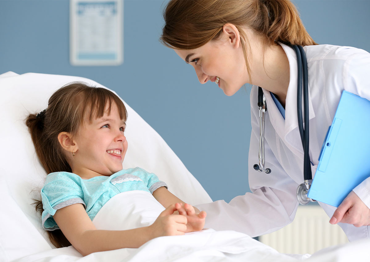 Lady Doctor checks on little girl patient