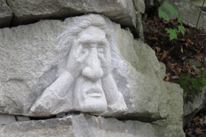 The Gnome carved into a granite block on Millstone Hill.